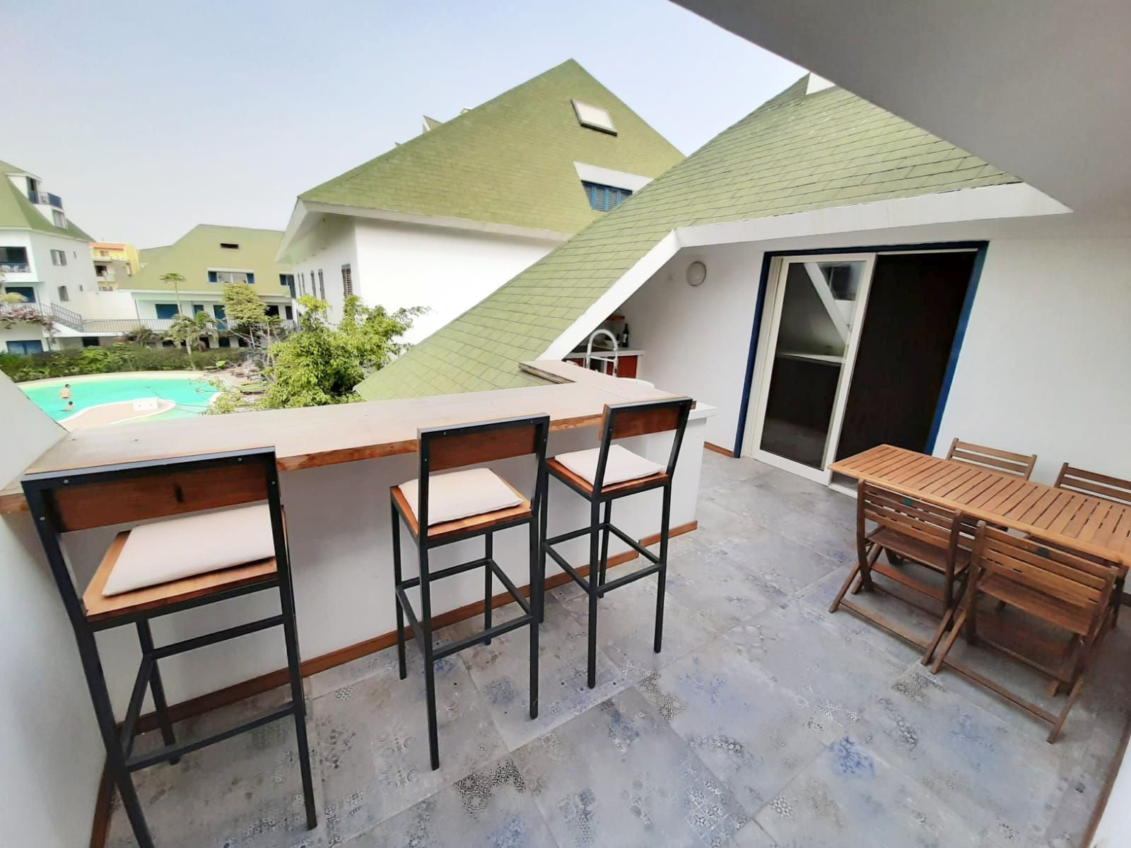 outside kitchen and bar with pool view, beach house for rent cabo verde, cape verde